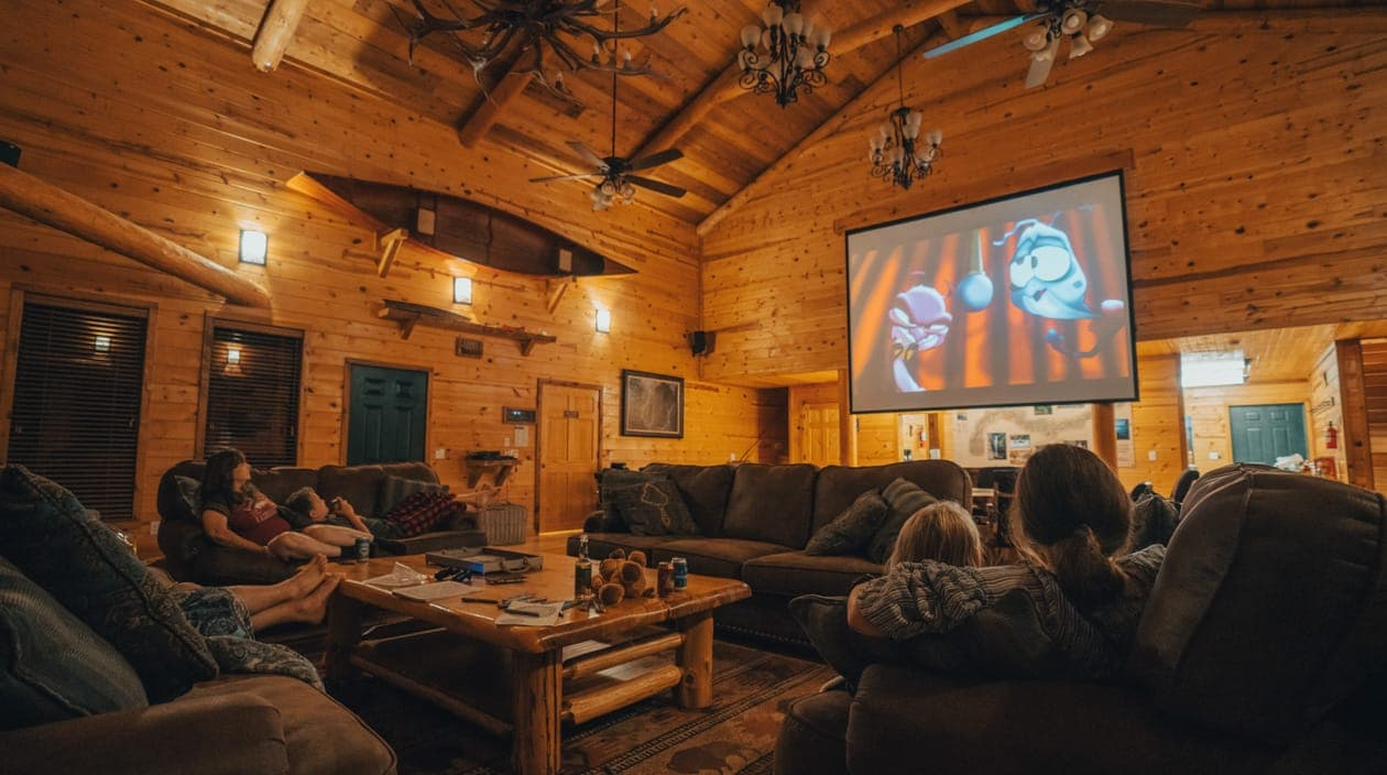 family watching a movie at Riverwind Lodge