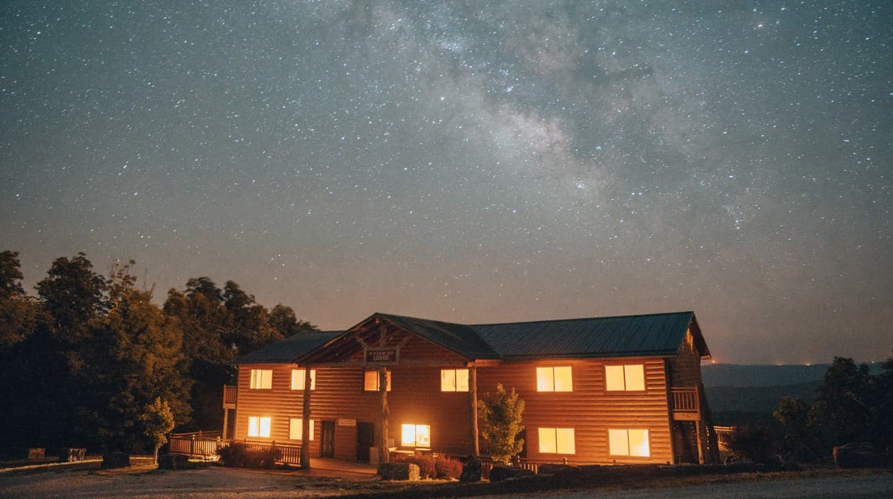 exterior of Riverwind Lodge at night